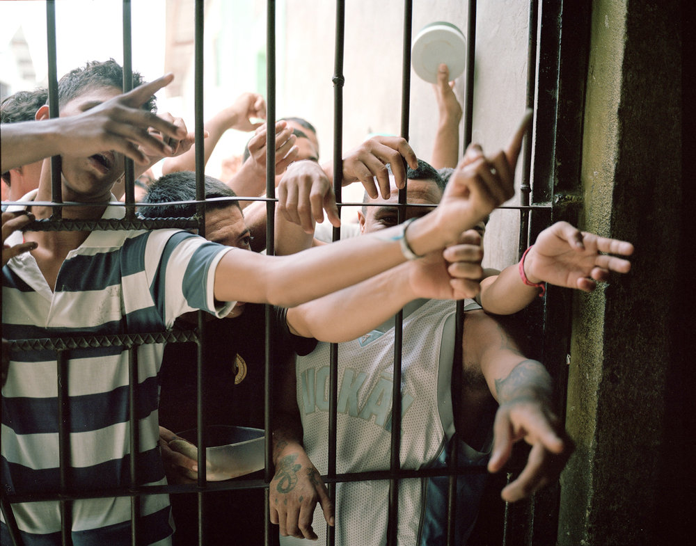 Prisoners beg church members for deodorant bars in the Comayagua Prison, where in 2012 a fire killed 360 people.