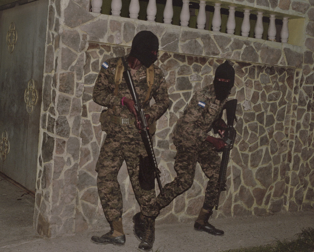 Honduran military engage gunmen who were hiding out inside a residence in San Pedro Sula.