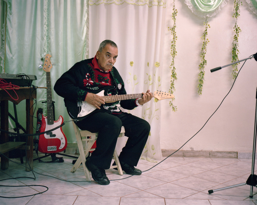 A man plays for a church group in Tegucigalpa.