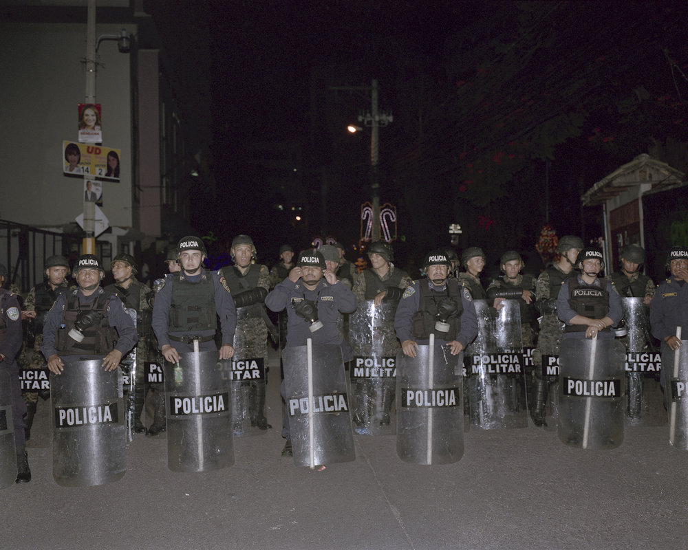 Riot Police wait for protestors to leave.