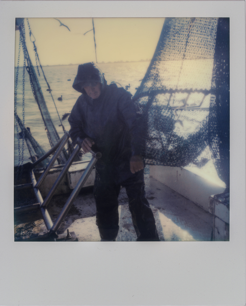 "Deckhand Arthur Miller sets nets off the coast of Galveston, Texas while shrimping for bait on the ""Sherry Diane."" (Dominic Bracco II / Prime for WWF Magazine)"