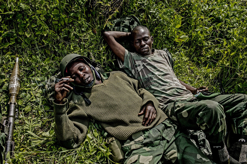 Congolese soldiers rest behind the frontline with M-23 rebels behind the frontline north of Goma.