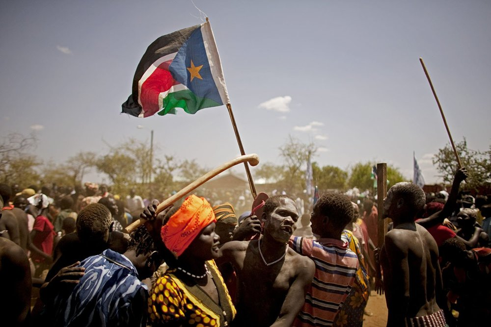 Southern Sudanese from the pastoralist Taposa tribe take part in a nationalist celebration in the remote area of Kapoeta. Support for southern independence is strong even among groups in the most desolate areas. Like numerous pastoral tribes in the south, many rural Taposa have little access to or strong interest in acquiring formal education. Despite a general lack of intellectual or practical connection to the institutions of independent government, the desire to see it come to fruition is overwhelming.
