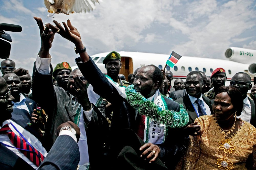 Salva Kiir (C-green sash), the President of the Government of South Sudan and Riek Machar (2nd L) release a dove upon Kiir's return from the United States. The two men were bitter enemies during the latter years of the civil war in southern Sudan. Machar aligned with the northern government in Khartoum and used his forces against Kiir and other SPLA commanders. The relationship is emblematic of the tense and distrusting alliances that define the southern political landscape.
