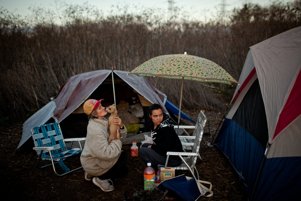 Evelyn Marrs-Benn, left, and Chanae Hanger hang out at the SafeGround homeless tent camp in Sacramento, California.