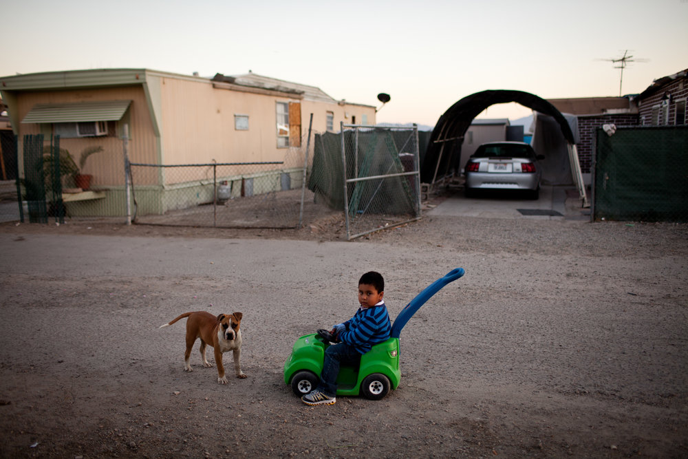 A three-year-old boy plays in the Rancho Garcia trailer park in Thermal, California.