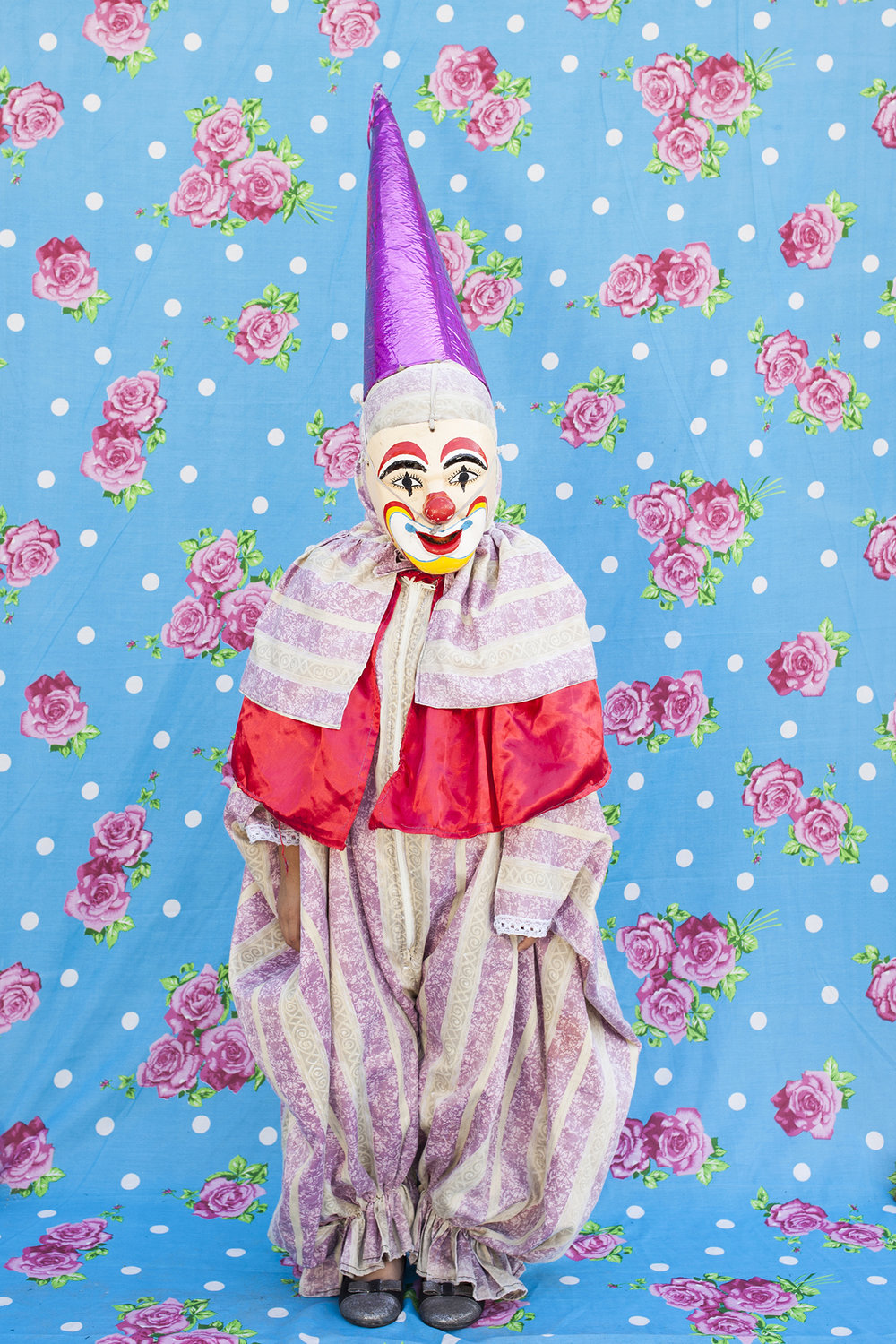 "Portrait of dancing clown with the typical costume. When they use their masks they prefer not to reveal their identity. From the gang ""Cuadrilla de Juquilita"", Coatepec, Veracruz, Mexico, 2016."