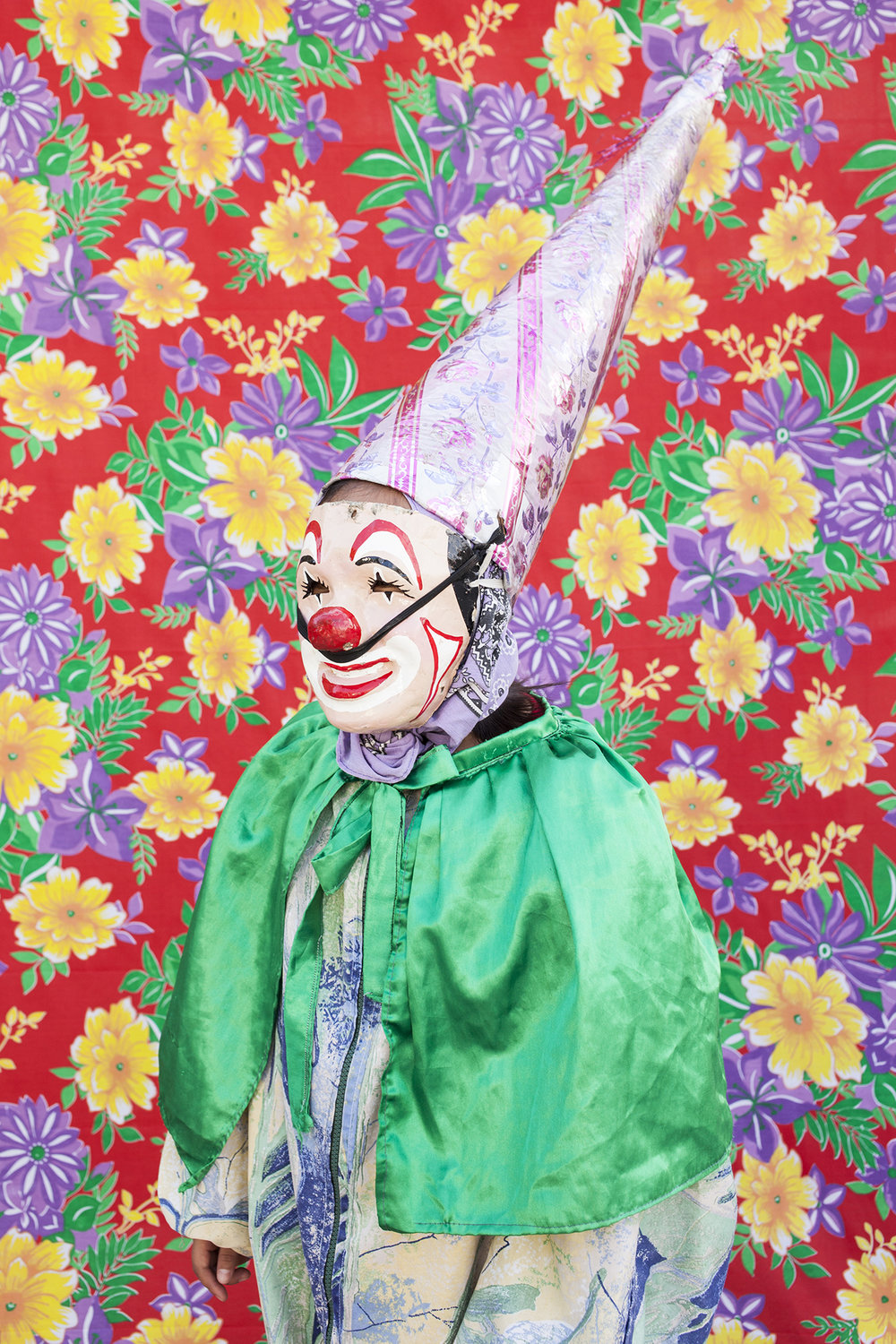 """Portrait of dancing clown with the typical costume. When they use their masks they prefer not to reveal their identity. From the gang """"Cuadrilla de Juquilita"""", Coatepec, Veracruz, Mexico, 2016."""