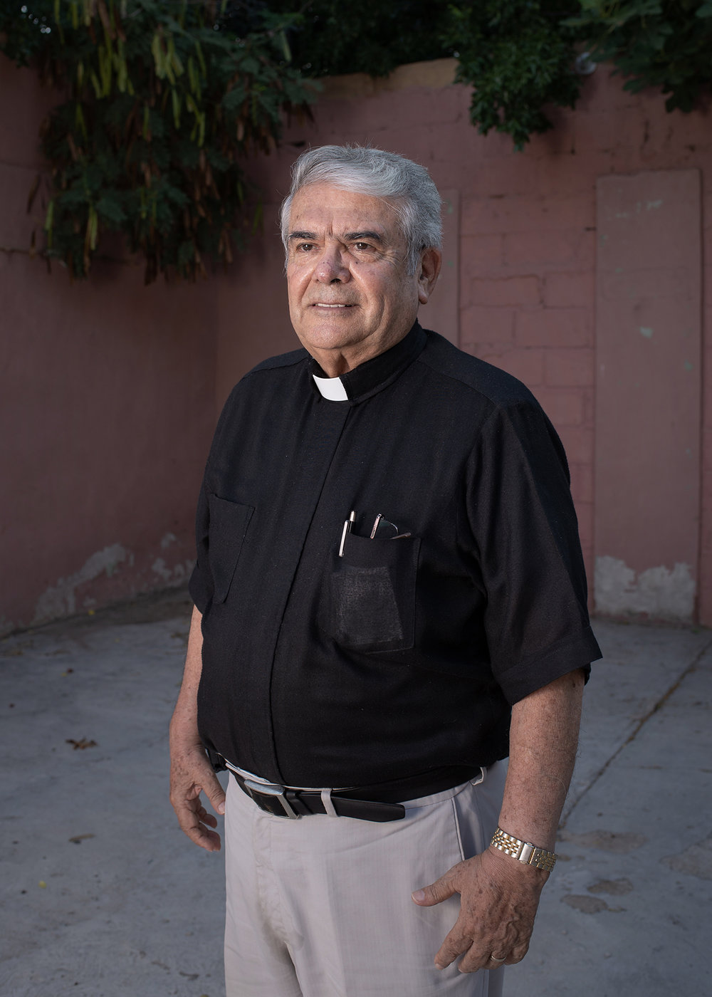 "Portrait of priest Jose Guadalupe Valdes Alvarado, creator of ""Casa del Migrante Frontera Digna"" and the dining room for migrants. The priest has a strong commitment helping people who arrive at Piedras Negras after a hard road with the intention of crossing to the United States in search of a better life. Piedras Negras, Coahuila, Mexico. June 22nd, 2018. Photographer: Luján Agusti."