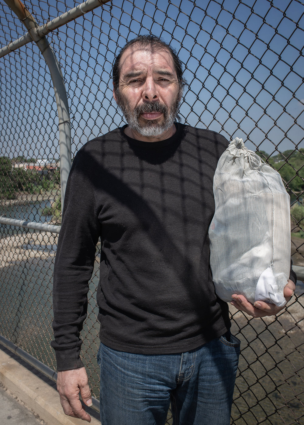 Portrait of Jesus Aragones Varal (52 years old) while crossing the Del Río / Ciudad Acuña International Bridge after being deported.  He had lived 19 years old in the United States, and had to leave his wife and son behind. Every Saturday morning a bus arrives carrying a group of deportees who were arrested and who are escorted to the Mexican side. Del Río / Ciudad Acuña International Bridge. June 23nd, 2018. Photographer: Luján Agusti.