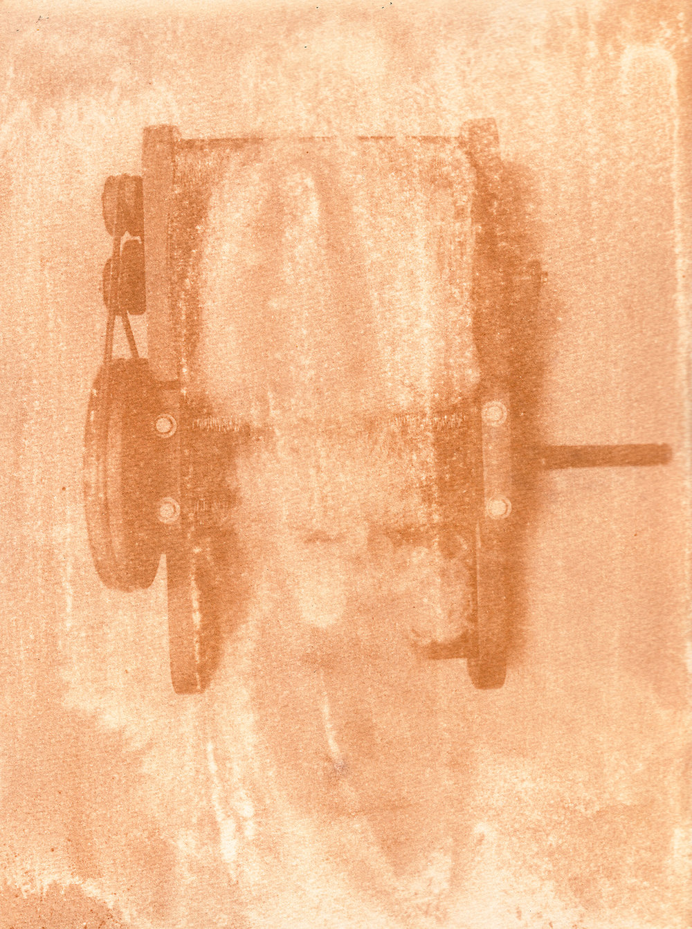 """Detail of a """"Cardadora"""" (Carding machine) used to comb the wool the """"Hilanderas del Fin del Mundo"""", a group of women dedicated to retake traditions of embroidery and weaving by invoking local production against the advance of imports using natural raw materials produced in the island. Anthotype scan made with natural dyes made with a mixture of roots of local plants such as Lupino, Calafate and Turmeric. Photographer: Luján Agusti. Tierra del Fuego. April 15th, 2018"""