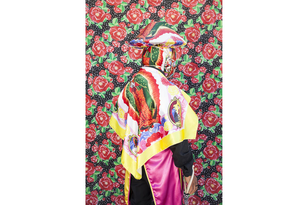 """Portrait the leader of the gang, showing the images of the Virgin of Guadalupe. He represents a Spaniard and is in charge of giving order to the dancers. Many of the clowns go out to dance by promise to the Virgin of Guadalupe.From the gang """"Cuadrilla de Juquilita"""", Coatepec, Veracruz, Mexico, 2016."""