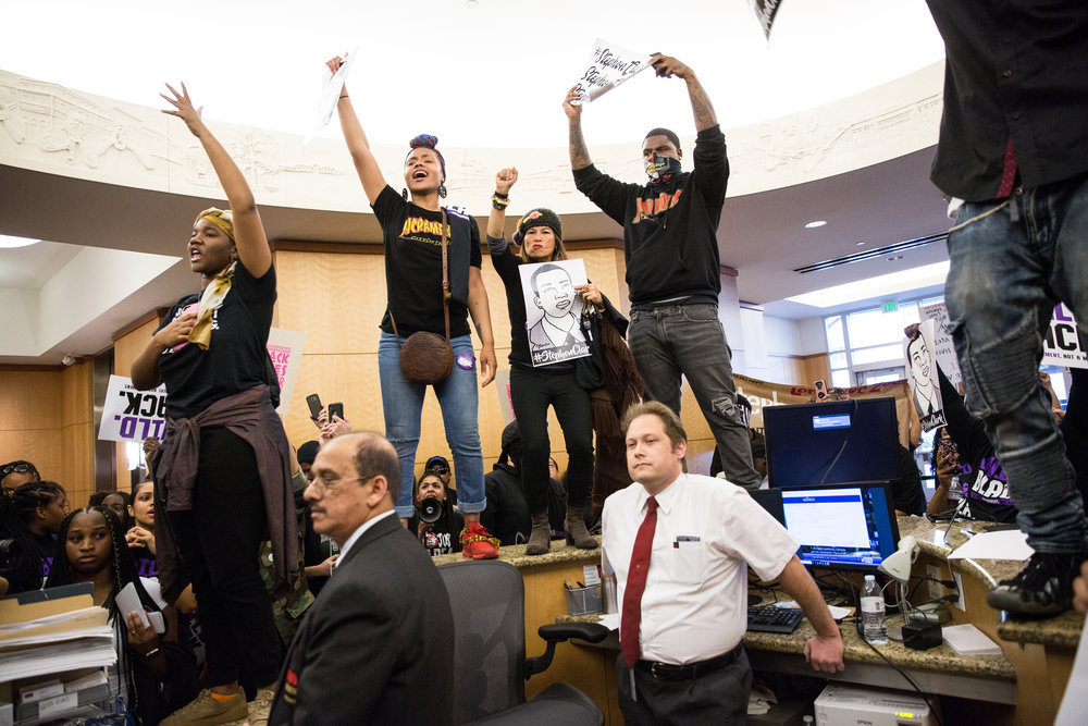 Protestors take over City Hall during a city council meeting on the police shooting of Stephon Clark.