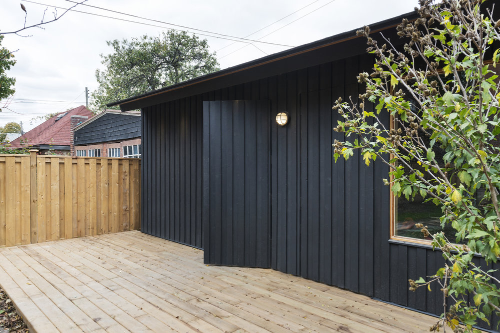 Doors were built to blend into Black Wood siding