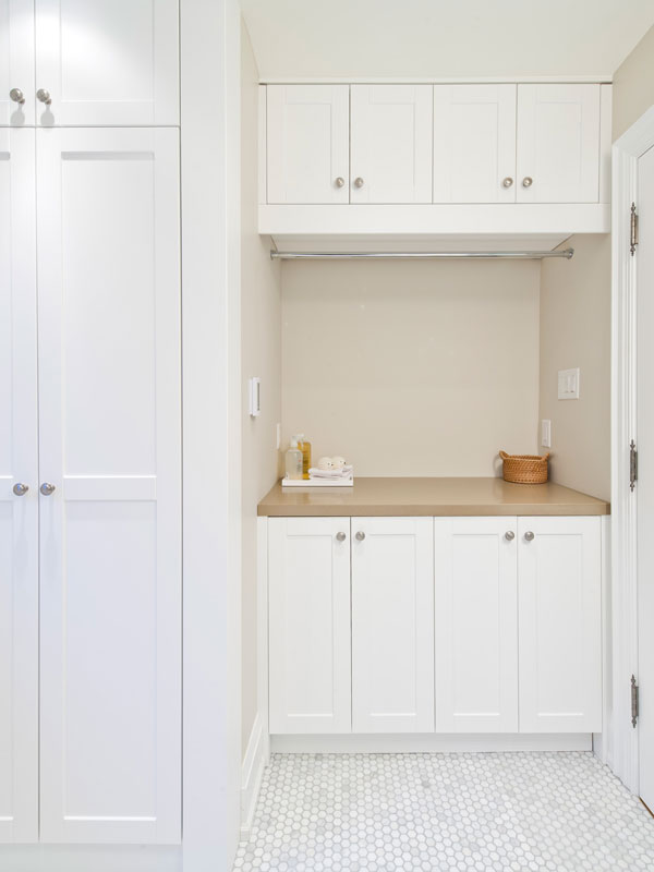 Laundry Millwork Conceals Washer and Dryer