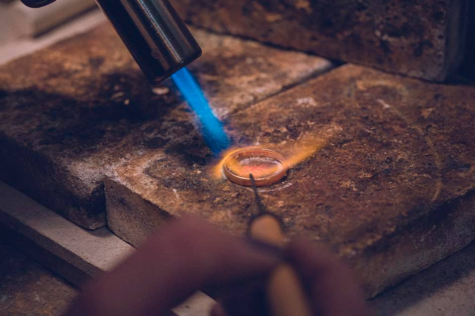 Melting gold into the perfect molten wedding ring.