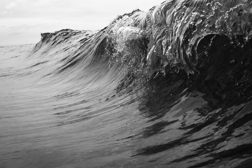 Taken moments before the waves crashed in upon themselves, this black and white photograph shows just how powerful the ocean can be.