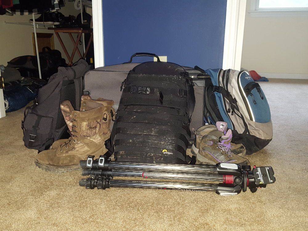 all of my gear - and melanie's - sitting in my room after coming from the trip