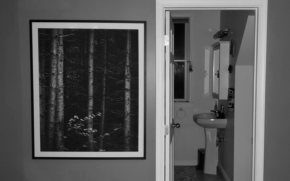 """A black and white snapshot of a large 32 x 40 inch print of my fine art photograph, """"Amongst The Dead,"""" currently displayed in a black frame with a 2"""" off-white mat."""