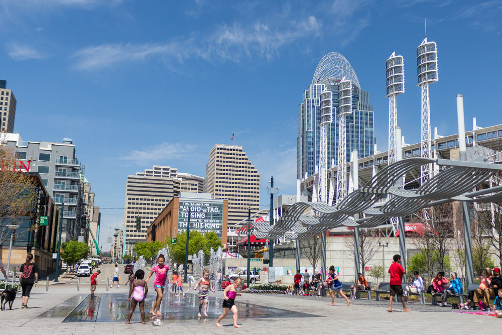 The fountains at Smale Riverfront Park with the Great American Ballpark in the background.