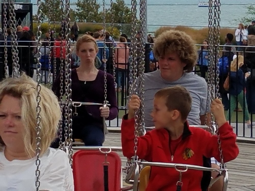 Making Faces on the Swings at Navy Pier
