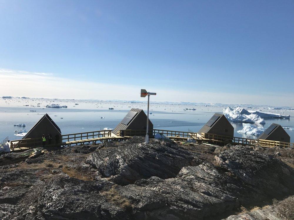Some of Ilimanaq Lodge's charming coastal cabins