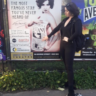 Romy with one of the show's posters in Edingburgh