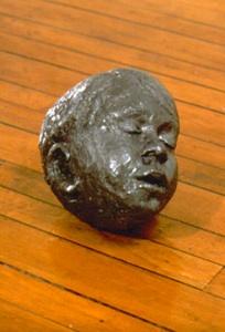 lead head, 1999 cast lead,23 x 19 x 24 cm.