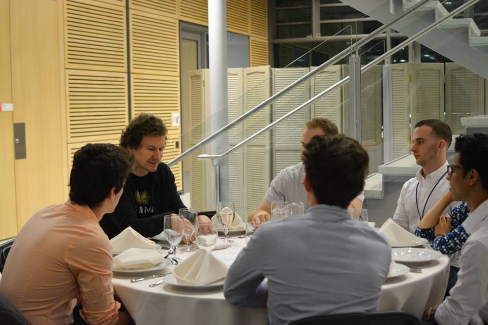 Students and speakers interact over dinner.