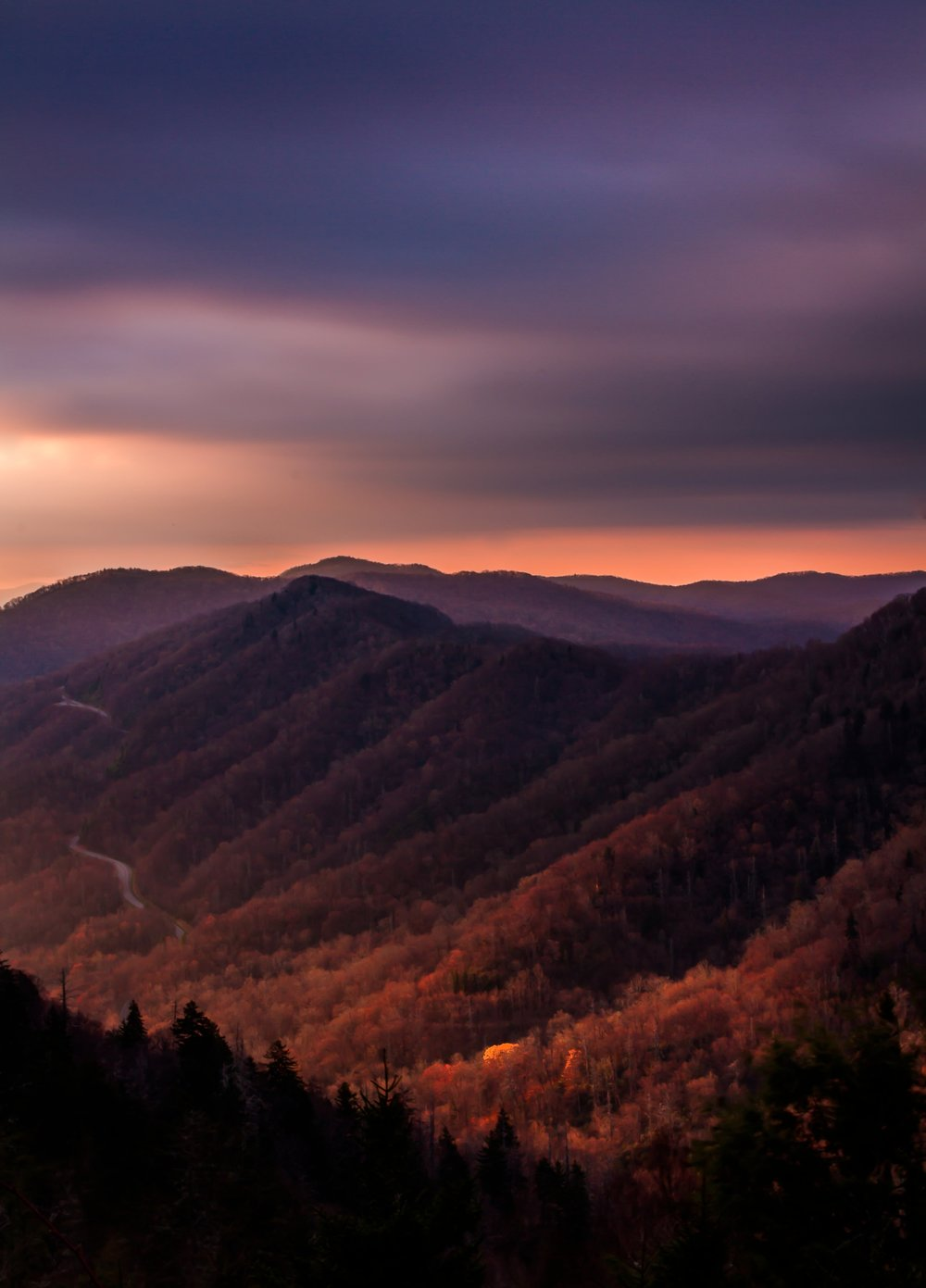 Sunrise in the Smokies. Taken with a Canon 7D with an EF-S 18-200 lens. f/22, shutter 5 sec., ISO 100.