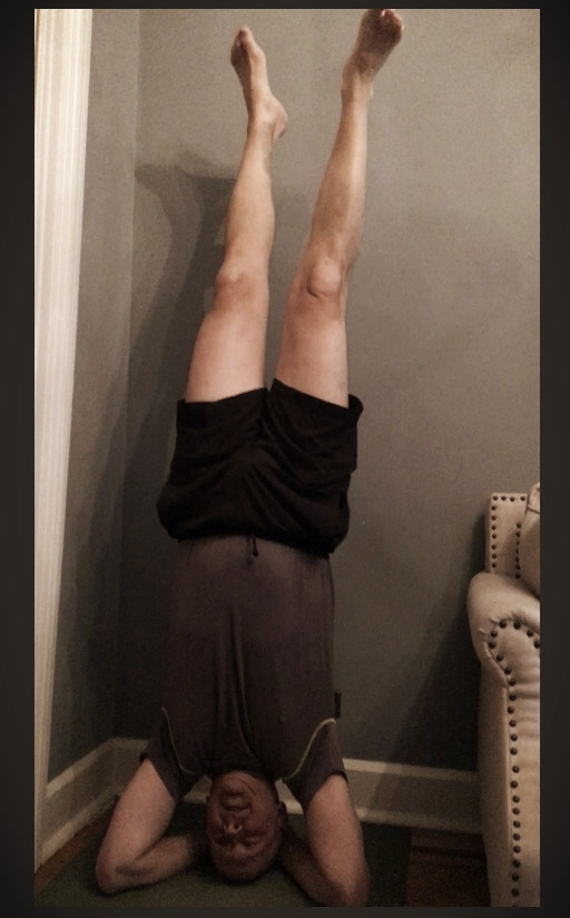 David quite accomplished in headstand fluttering his feet.