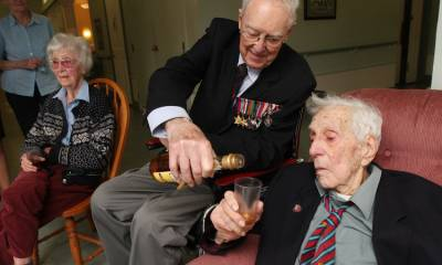 ( photo is of the late David M. Dickson and the late Nelson Adams, both of whom were part of the D-Day invasion forces .)