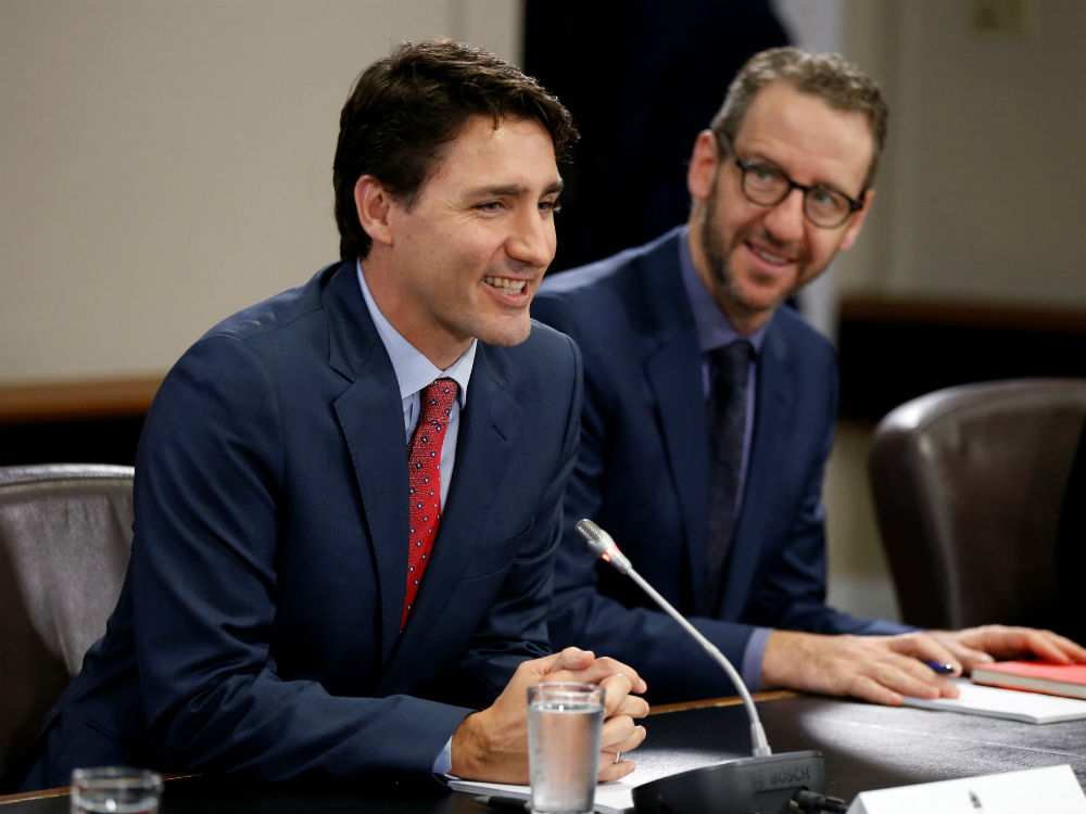 Trudeau and long time friend and until yesterday Principal Secretary Gerald Butts. Photo Credit: Chris Wattie/Reuters