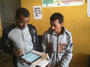 SCOPE data collector Mehari gathering information from a health center staff member