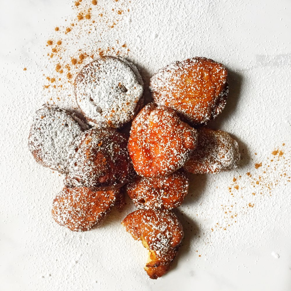 warm banana puffs dusted with cinnamon & confectionary sugar