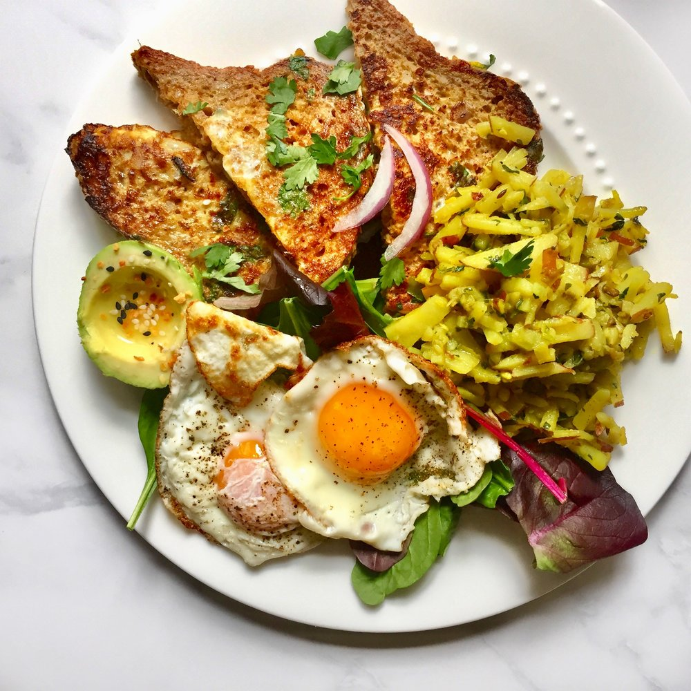 green onion & cilantro multi-grain french toast with avocado, eggs, and bangladeshi sautéed potatoes (aloo bhaji)