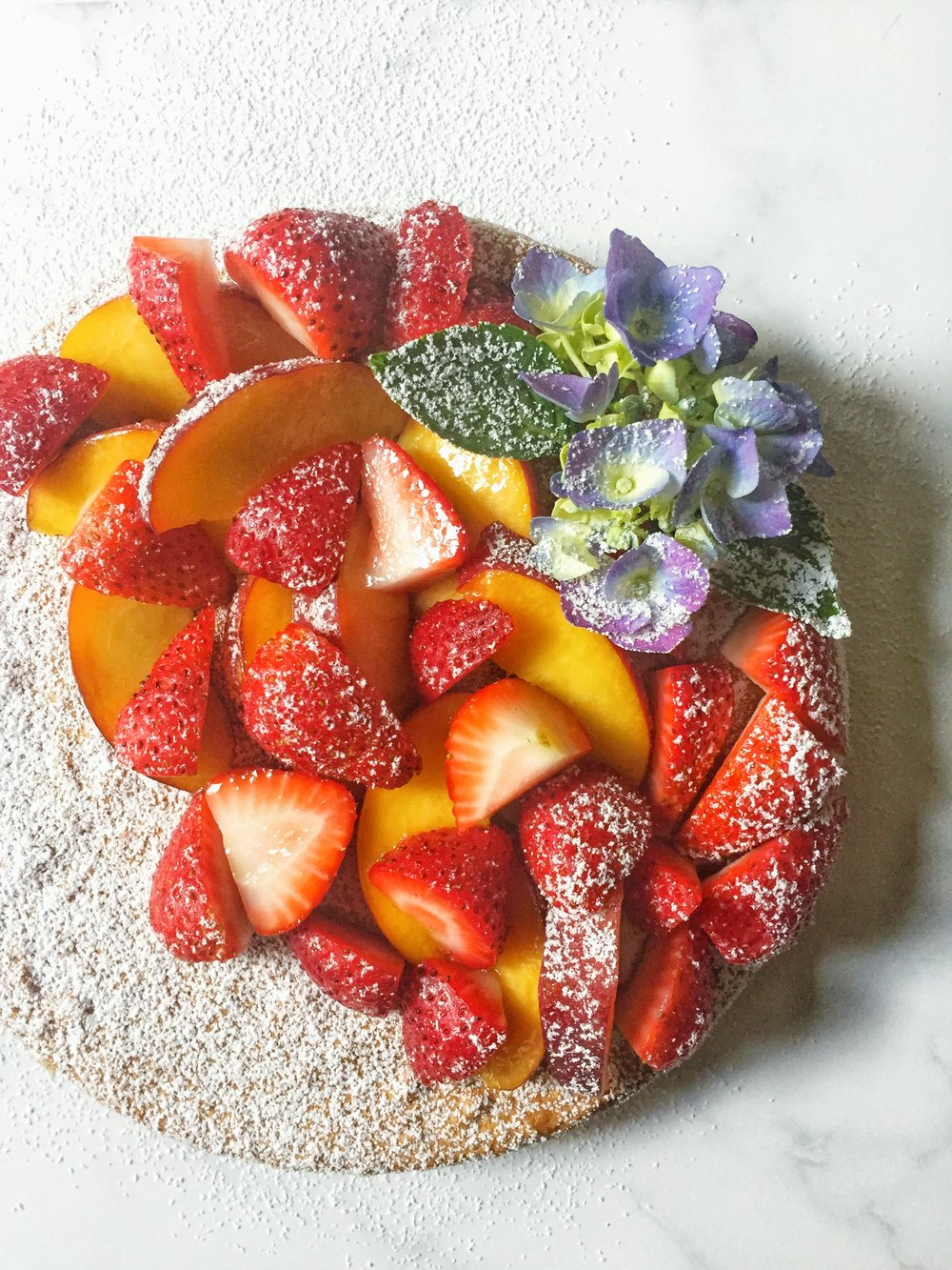 summer almond cake with fresh berries and peaches