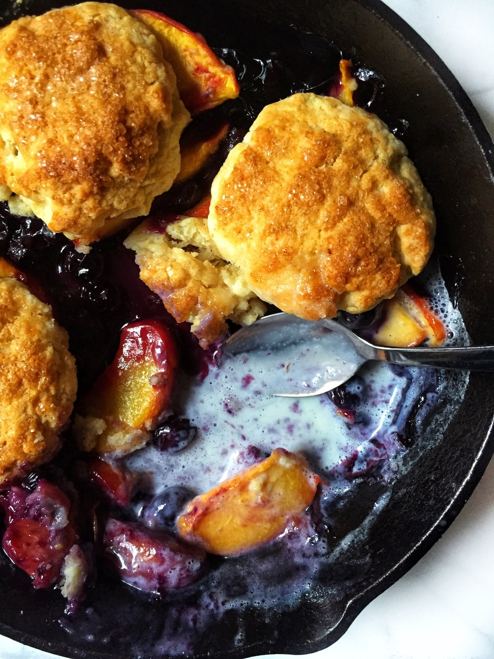 warm blueberry & peach cobbler with biscuits and sweet cream