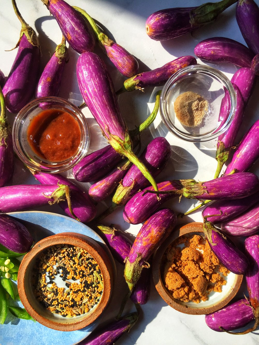 fairy tale eggplants with panch phoron, tamarind, palm sugar, and green chilies