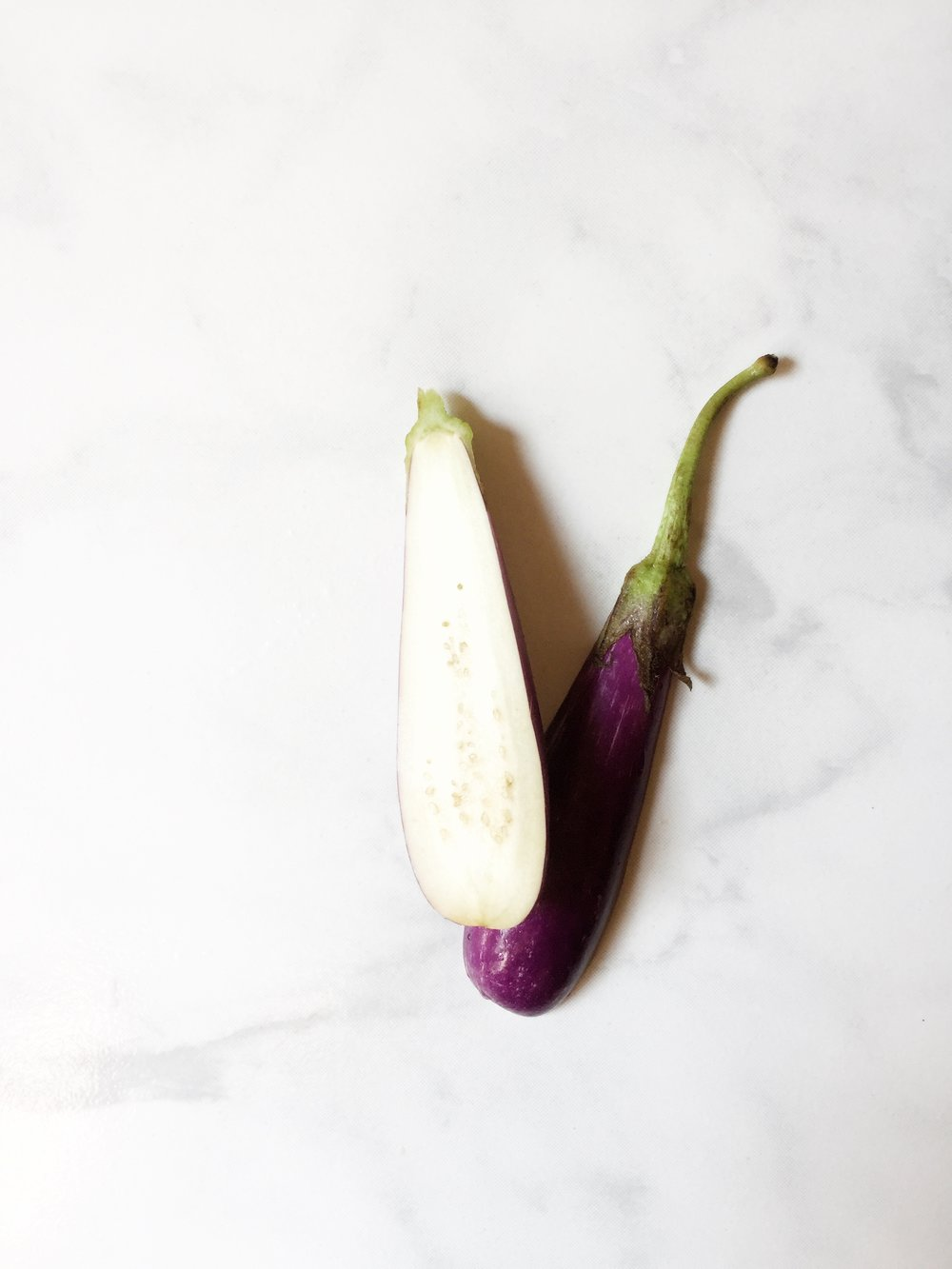 I've used fairy tale eggplants, but I recommend Italian or Japanese dark purple eggplants for Bengali begun'er tok.