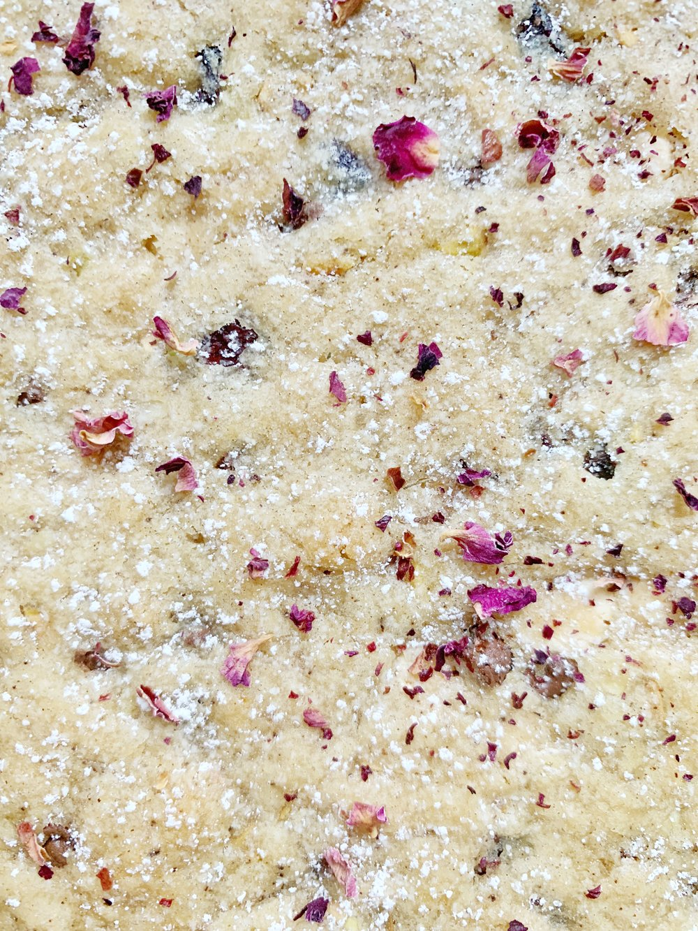 brown butter blondies with pistachios, cranberries, white chocolate, and rose petals by Afsana Liza