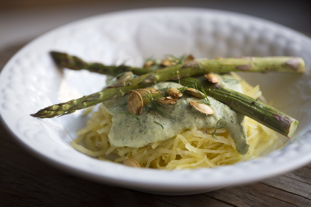 spaghetti squash pasta with a dill alfredo sauce topped with roasted asparagus and seeds (from the squash).
