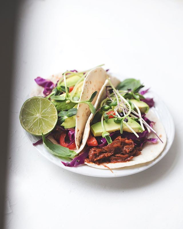"vegan ""pulled pork"" tacos featuring a delicious purple cabbage slaw and yummy sunflower sprouts 😩😍 (#linkinbio for the sandwich version) . sooo, look...it's been awhile. between moving out of the country, coming back, moving to nyc, and trying to navigate this jungle of a city, things have been hectic. basically, herbanistic has been on a long ass hiatus. . after settling in a bit (it's been three months!), i finally feel like i'm ready to produce content on a steady basis again. running a food blog is NOT easy y'all. it takes time, dedication, money, and more goddamn time. spending hours in the kitchen creating fun and unique recipes to later photograph, film, AND edit all while trying to survive in one of the most expensive cities in the world is...daunting. BUT after taking my time to carefully create a content schedule that allows breathing room, i'm ready 🙌🏿 . soooo excited to get back into the swing of things! i've missed y'all so much 😭 be sure to shoot me any recipe requests you have, as well as any vegan-related topics you'd like to see me discuss via video. . remember, if you want to learn how to make this quick and easy taco dish, follow the link in the bio 🌸"