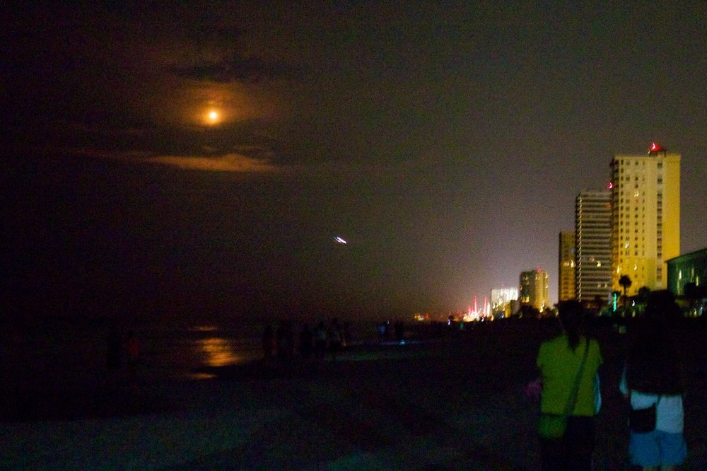 That's not the moon! It's a rocket launched from Cape Canaveral.