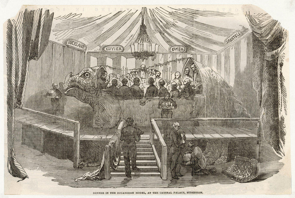 19th-century exotic animal eating club meeting in a model of an iguanodon