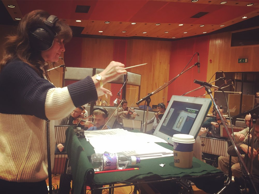 Composer Debbie Wiseman MBE conducting the orchestra at Angel Studios in London