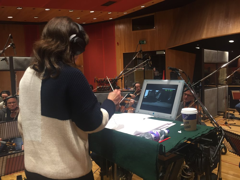 Composer Debbie Wiseman MBE conducting a music cue