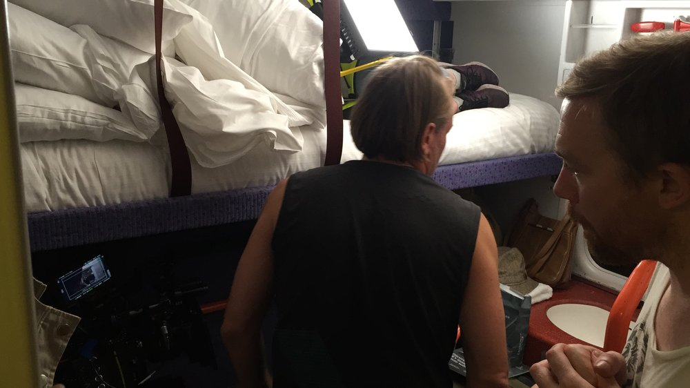 Filming inside the sleeper train at Euston station in London.