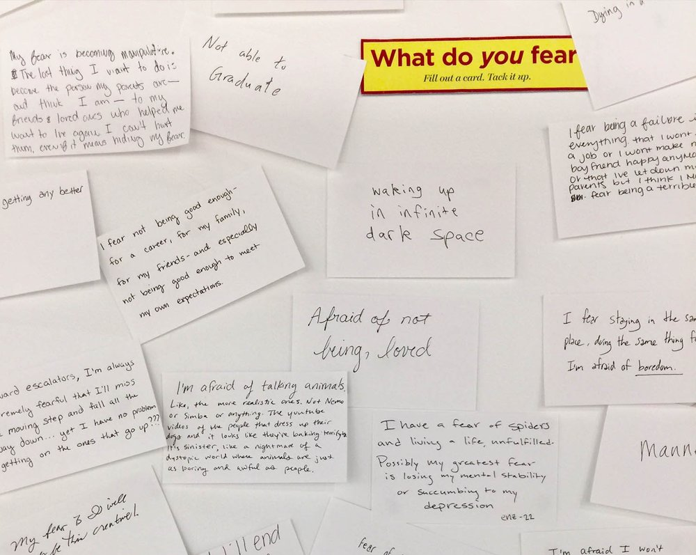 Visitors to a recent exhibition of Fear, Illustrated shared their fears on index cards and tacked them to a wall in the gallery space.