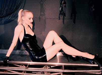 Den of Iniquity, Medical Room. Victoria wearing a Syrene latex dress.